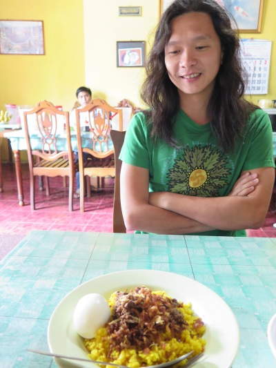 Chriswan communing with his favourite nasi kuning.